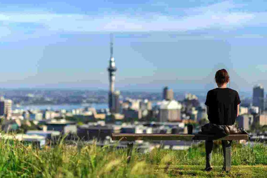 Woman enjoys spectacular morning views of Auckland city, New Zealand