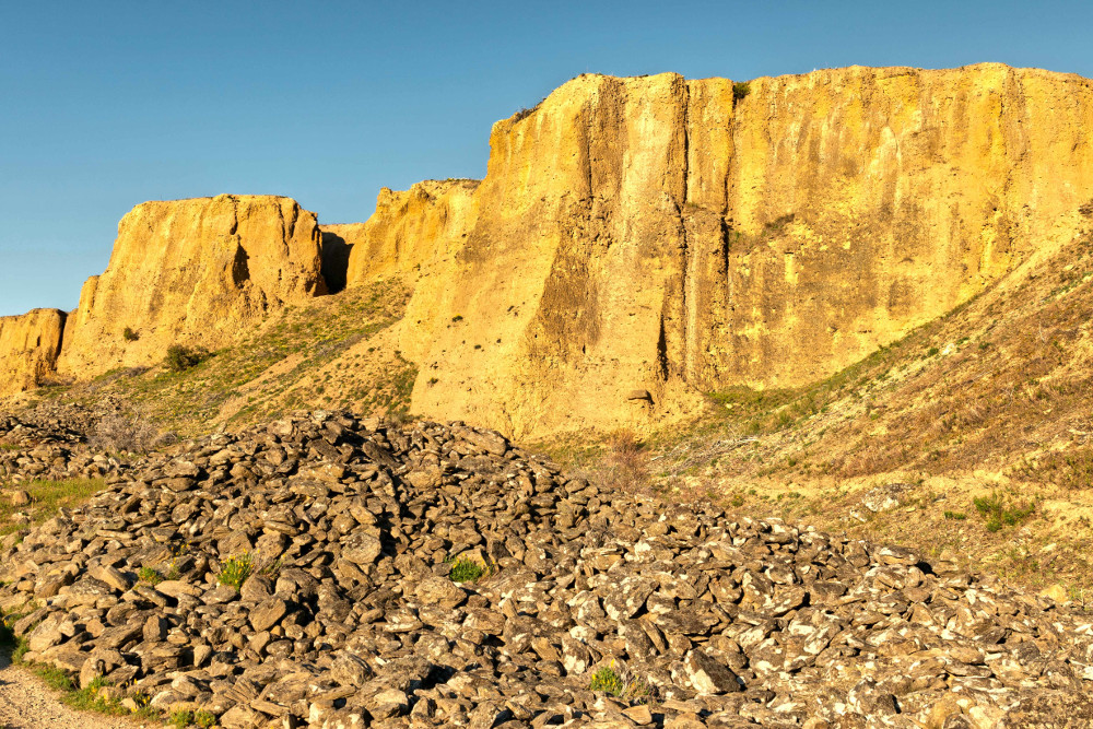 Bannockburn sluicing striped hillsides evidence of the harsh environment resulting from gold mining Otago, New Zealand