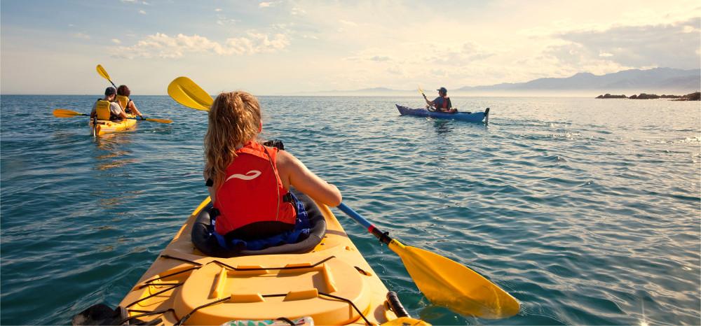 Family Sea kayaking off Kaikoura, New Zealand