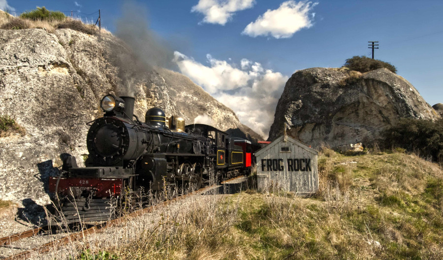 Steam train passing Frog Rock, Canterbury, South Island,New Zealand