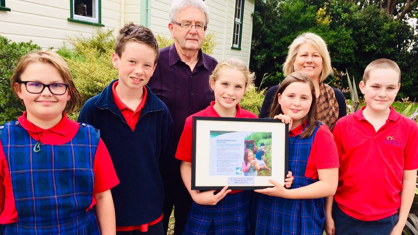 Doug Hutchinson stands with a group of children who formed a conservation group called 'Habitat Heroes' @Jacob McSweeny NZHerald