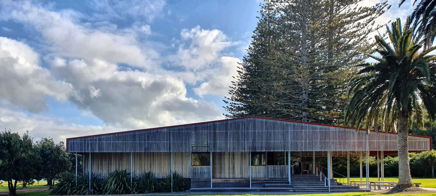 Exhibition Centre framed by historic Norfolk pines