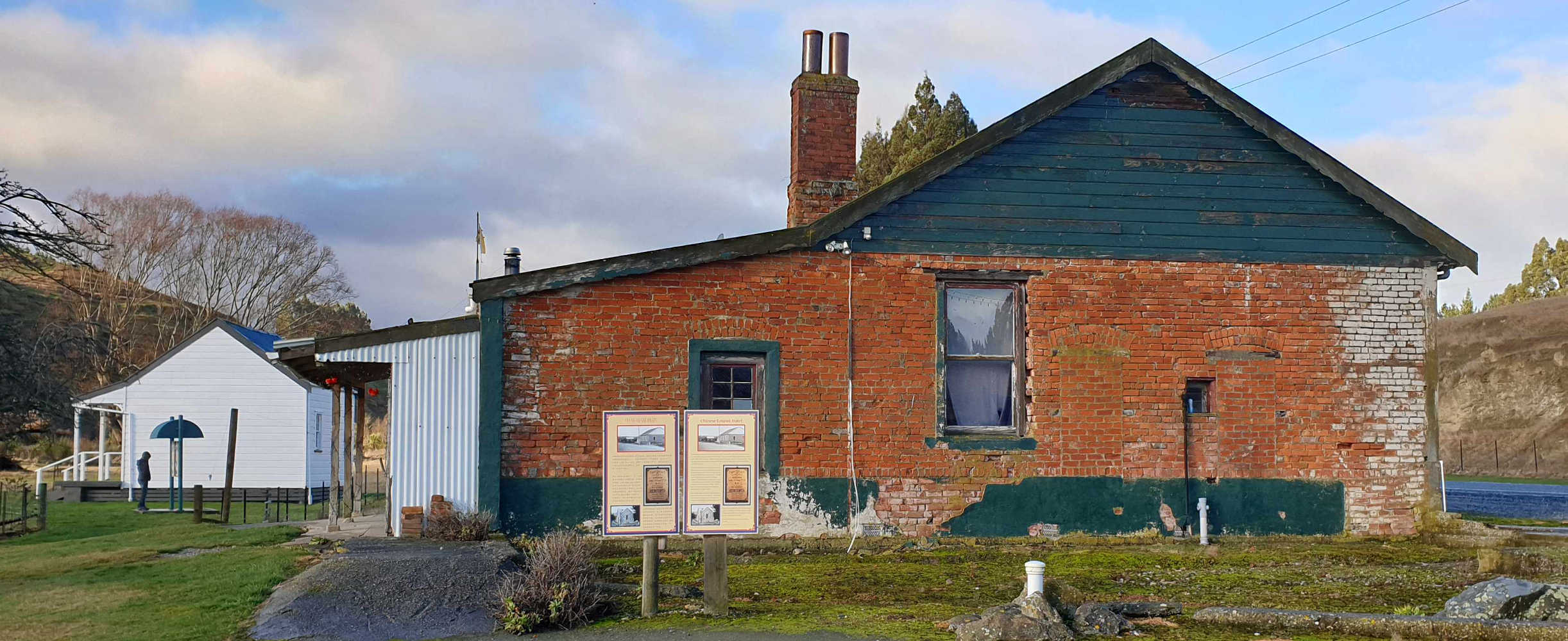 Historic pub in Chinese Mining Precinct, Lawrence, Joss House in background,New Zealand