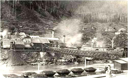 View of the coal mining town of Brunner, showing the bridge and mine. Ref; PA1-0-498-36, Alexander Turnbull Library, Wellington, New Zealand