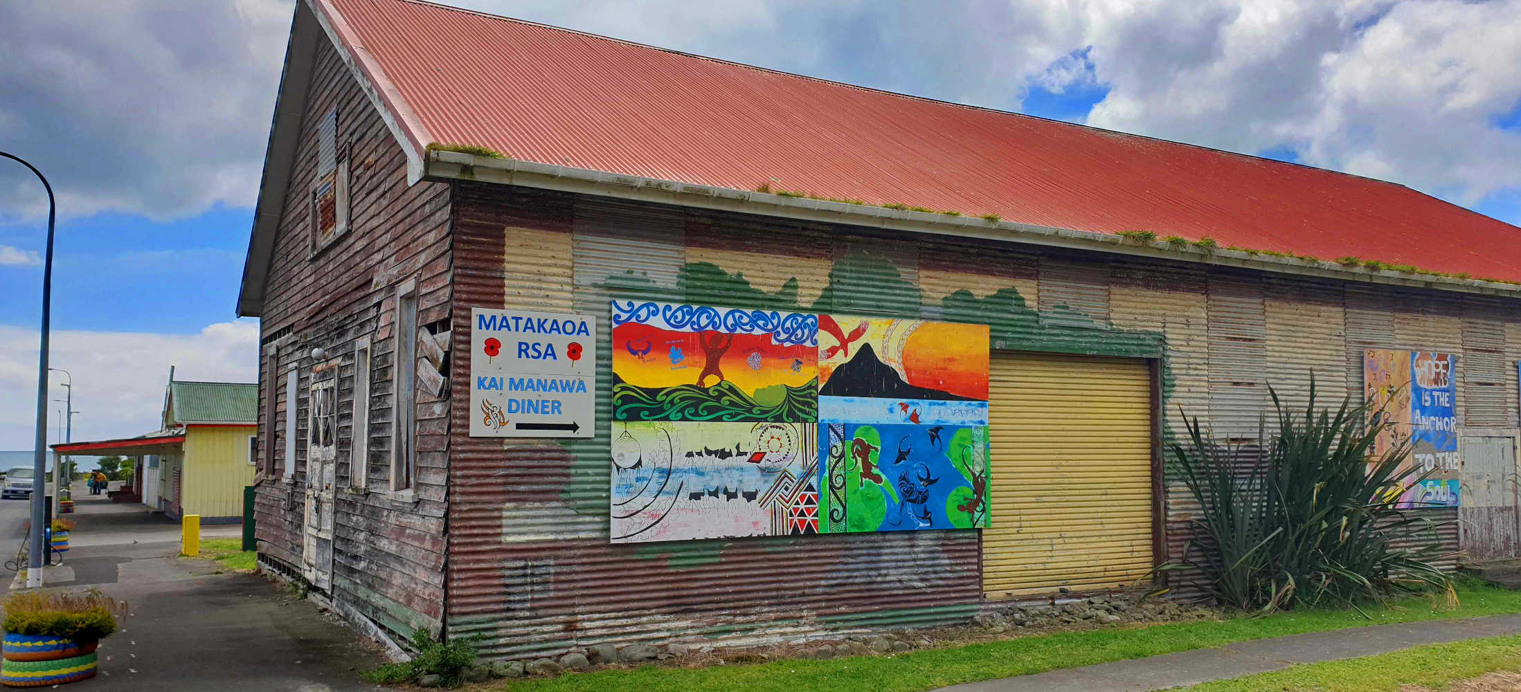 Te Araroa streetscape with an abandoned building and cheerful side art,New Zealand