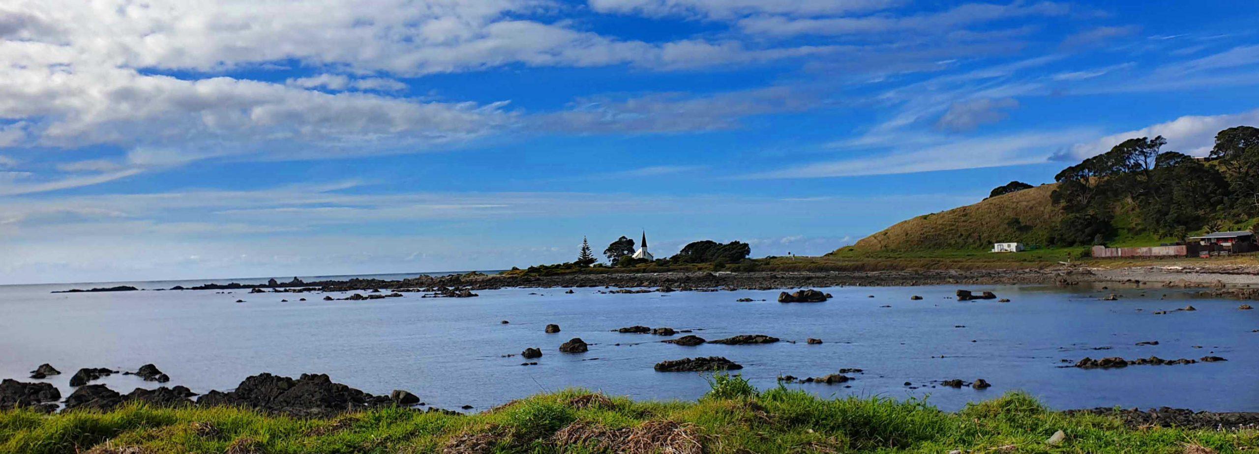 WAIHAU BAY view of iconic white spire of Anglician Raukokore Church,New Zealand